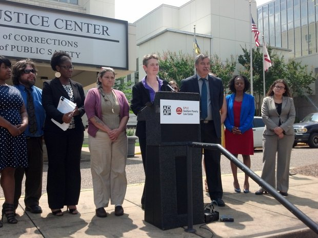 Maria Morris, managing attorney for the Southern Poverty Law Center, announces a federal lawsuit against the Alabama Department of Corrections alleging that the system violates federal law by ignoring inmates' medical and mental health needs. Morris spoke outside DOC's offices in Montgomery, Ala., on June 17, 2014. Morris was joined by William Van Der Pol Jr., staff attorney for the Alabama Disabilities Advocacy Program, which is also taking part in the lawsuit, alleging discrimination against prisoners with disabilities. (Mike Cason/mcason@al.com)