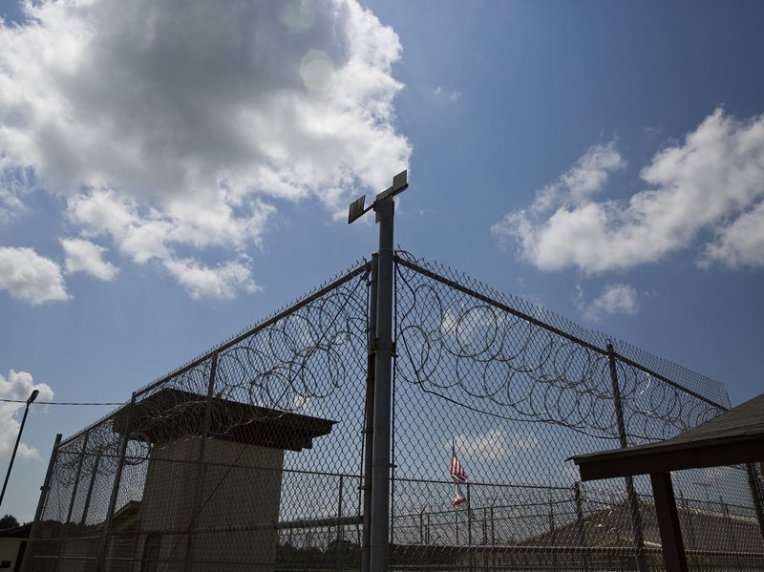 "A fence stands at Elmore Correctional Facility in Elmore, Ala., seen in 2015. A federal judge ruled that mental health care for inmates is ""horrendously inadequate."""