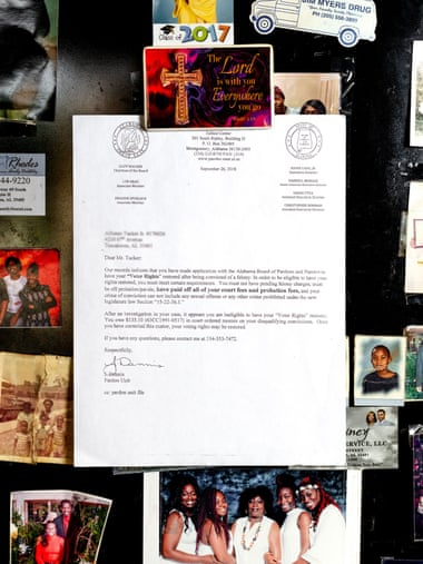A letter hangs on Alfonzo Tucker's refrigerator stating that his right to vote has been revoked. Photograph: Johnathon Kelso/The Guardian