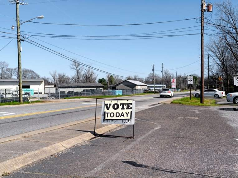 A voting sign near a main street in Tuscaloosa. Photograph: Johnathon Kelso/The Guardian