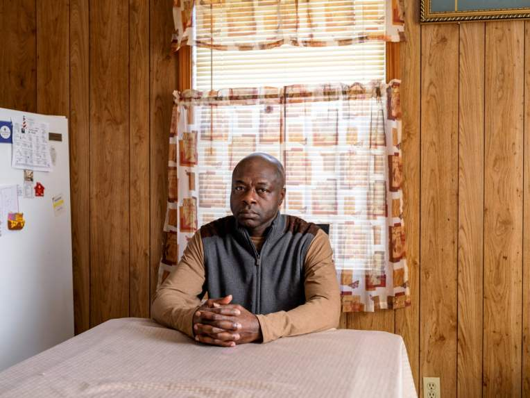 Alfonzo Tucker photographed at his home in Tuscaloosa. Photograph: Johnathon Kelso/The Guardian